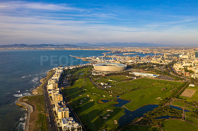 Buy stock photo Landscape shot of Cape Town's coastal city and a surrounding mountain during the day