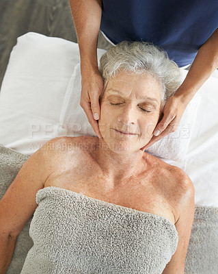 Buy stock photo Cropped aerial shot of a relaxed senior woman enjoying a head massage at the spa during the day