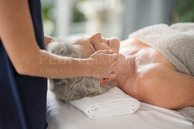 Buy stock photo Cropped shot of a relaxed senior woman enjoying a head massage at the spa during the day