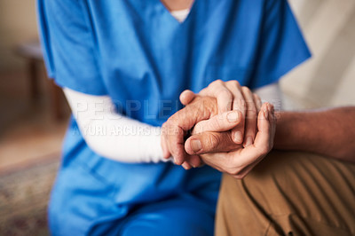 Buy stock photo Cropped shot of a female nurse hold her senior patient's hand