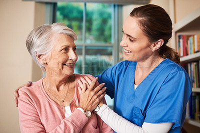 Buy stock photo Cropped shot of a female nurse with her senior patient
