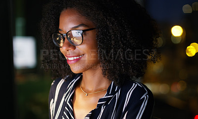 Buy stock photo Cropped shot of a young attractive businesswoman wearing glasses and working while in the office late at night