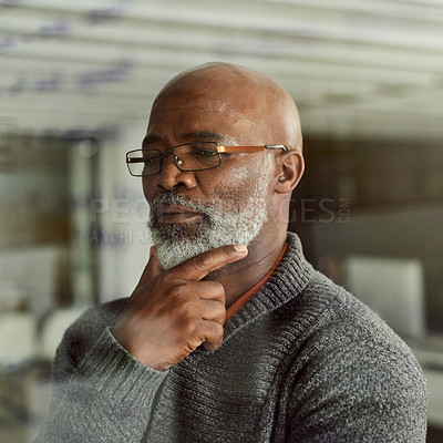Buy stock photo Cropped shot of a mature businessman looking thoughtful in an office