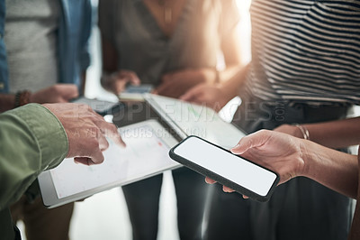 Buy stock photo Cropped shot of a group of businesspeople using a digital technology during a meeting at work