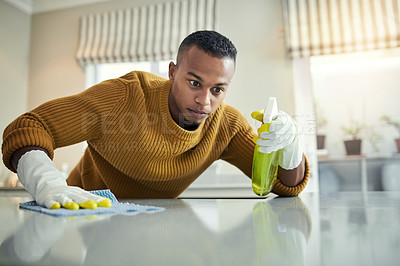 Buy stock photo Cropped shot of a young man cleaning his home