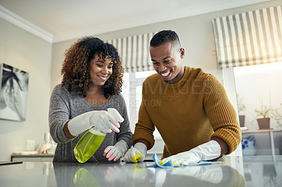 Buy stock photo Cropped shot of a young couple cleaning the kitchen together