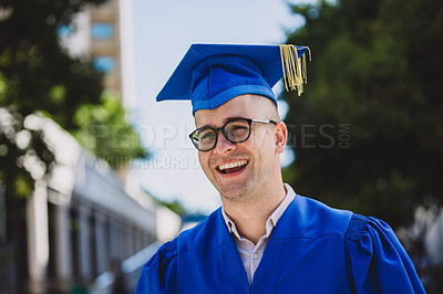 Buy stock photo Shot of a happy young man on graduation day