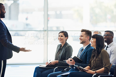 Buy stock photo Shot of a young businessman delivering a speech during a conference