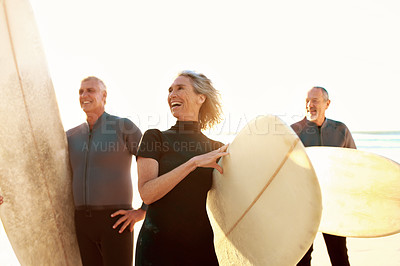 Buy stock photo Cropped shot of a group of happy senior people holding their surfboards on the beach before surfing during the day