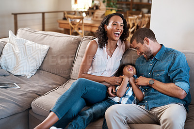 Buy stock photo Shot of a young boy being tickled by his parents