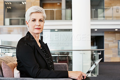 Buy stock photo Portrait of a mature businesswoman sitting on a chair in an airport lounge