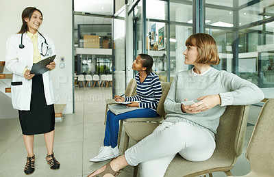 Buy stock photo Shot of a doctor greeting her patient in the waiting room of a clinic