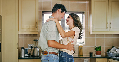 Buy stock photo Cropped shot of a young couple dancing in the kitchen at home