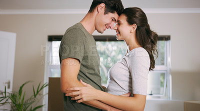 Buy stock photo Cropped shot of an affectionate couple at home