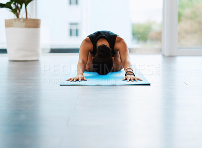 Buy stock photo Shot of an unrecognizable young woman practicing yoga inside a studio