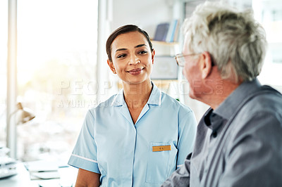 Buy stock photo Shot of a young nurse caring for a senior man