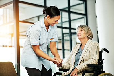 Buy stock photo Shot of a young nurse caring for a senior woman with a wheelchair