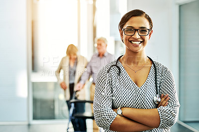 Buy stock photo Portrait of a confident young nurse with her elderly patients in the background