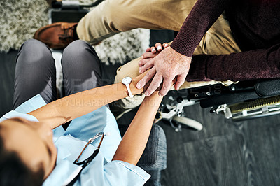 Buy stock photo Cropped shot of a nurse holding hands with a senior patient