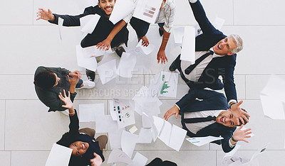 Buy stock photo Aerial shot of a diverse group of businesspeople throwing paperwork in the air in celebration while in the office