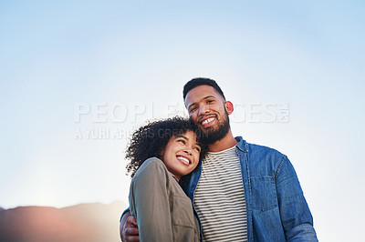 Buy stock photo Cropped shot of an affectionate young couple holding each other while on a date outside during the day