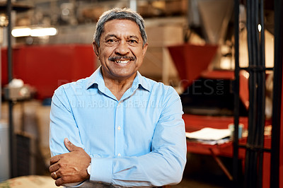 Buy stock photo Shot of a confident mature man working in a factory
