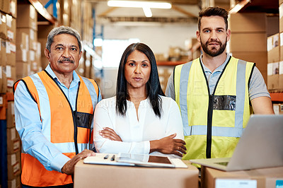 Buy stock photo Cropped portrait of three warehouse workers checking on distribution logistics