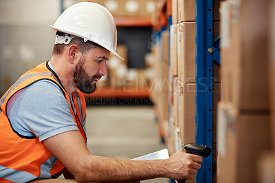 Buy stock photo Shot of a young man using a barcode reader and digital tablet in a warehouse