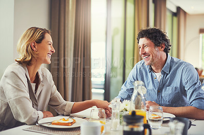 Buy stock photo Shot of a mature couple having a leisurely breakfast together at home