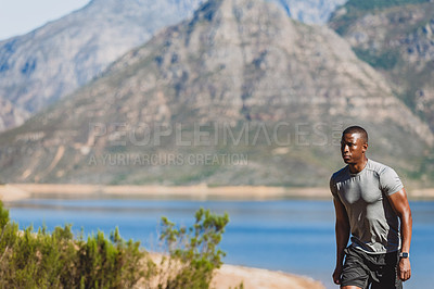 Buy stock photo Cropped shot of a sporty young man walking back after his run