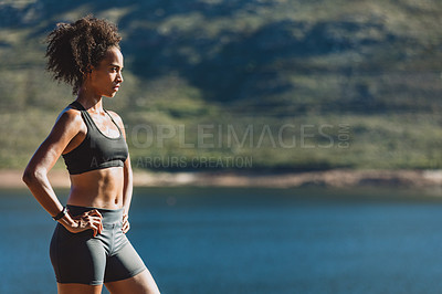 Buy stock photo Cropped shot of a sporty young woman standing outdoors