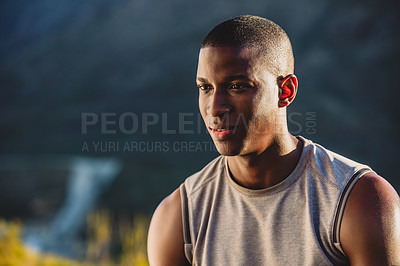 Buy stock photo Cropped shot of a sporty young man exercising outdoors