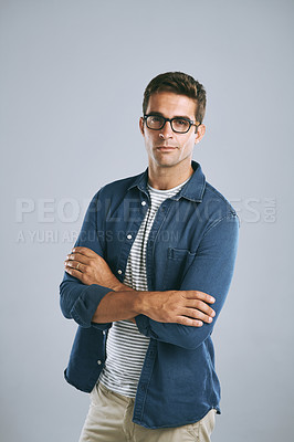 Buy stock photo Cropped shot of a handsome man wearing glasses against a grey background