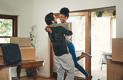 Buy stock photo Cropped shot of an affectionate middle aged man lifting his wife in celebration in their new home