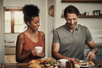 Buy stock photo Cropped shot of an affectionate young couple having breakfast in their kitchen at home