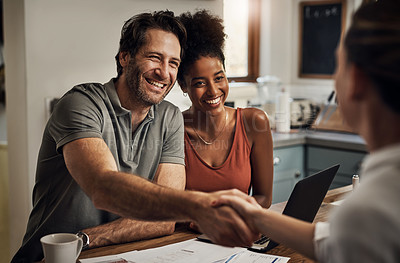 Buy stock photo Cropped shot of a handsome middle aged man shaking hands with a financial advisor during a consultation at home