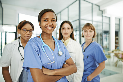 Buy stock photo Shot of a group of young doctors working together in a modern hospital