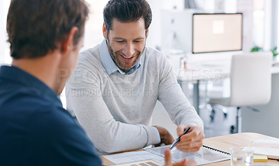 Buy stock photo Shot of two businessmen having a discussion in an office