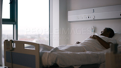 Buy stock photo Shot of a senior patient lying in a bed in a hospital ward