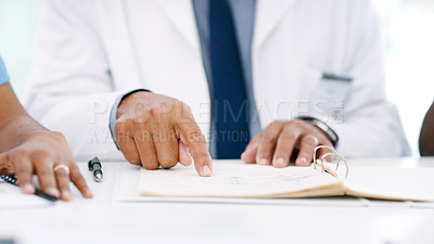 Buy stock photo Closeup shot of a group of medical practitioners having a meeting in a hospital boardroom