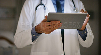 Buy stock photo Closeup shot of an unrecognisable doctor using a digital tablet in a hospital