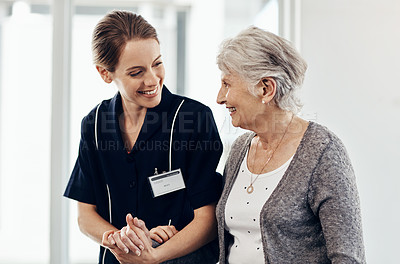 Buy stock photo Cropped shot of a female nurse caring for a senior woman