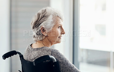 Buy stock photo Cropped shot of a senior woman looking thoughtful while sitting in her wheelchair