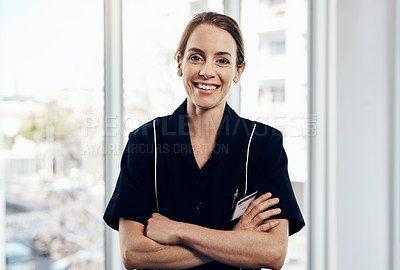 Buy stock photo Cropped shot of a young female caregiver smiling at the camera