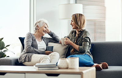 Buy stock photo Cropped shot of a senior woman and her adult daughter sitting together at home