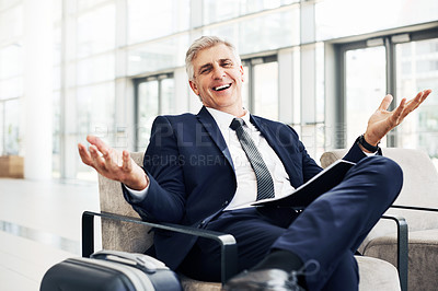Buy stock photo Cropped portrait of a handsome mature businessman sitting in an airport terminal during the day