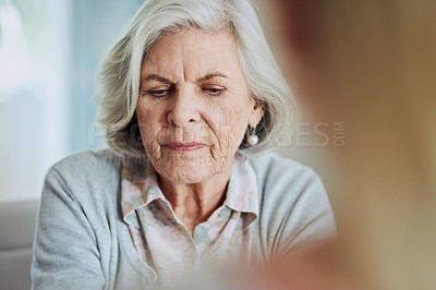 Buy stock photo Shot of a senior woman at home with her adult daughter