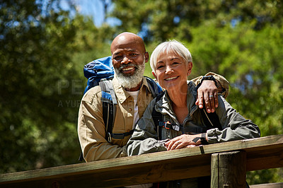 Buy stock photo Shot of senior people hiking outdoors in the mountain