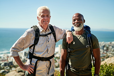 Buy stock photo Portrait of two cheerful cheerful senior men posing together while hiking out in the mountains