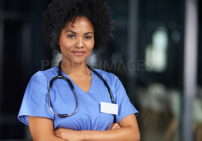 Buy stock photo Portrait of a young medical practitioner standing with her arms crossed in a hospital